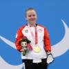 Danielle Doris wins god in the women's 50m butterfly in Tokyo